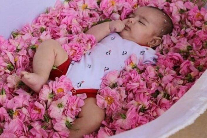 Infants Rolling in Flowers